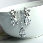 A Rhodium Plated Cubic Zirconia Flower, Silver Plated Frame Cubic Zirconia Pear Jewelry Set