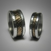 Rustic unique brass and silver artisan wedding band set