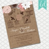 Pink Bird Cage Wedding Invitation on Brown Linen