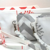 wristlet clutch in gray and coral
