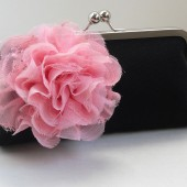 Black clutch with pink blossom pin