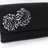 Black fold over clutch with striped fabric flower