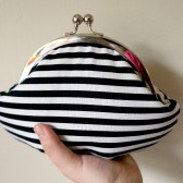 Black and white striped clutch wristlet