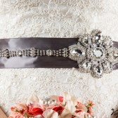 Grey sash with statement crystal flower