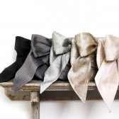 Silk envelope bow clutch
