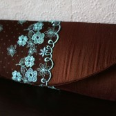 Chocolate brown and turquoise clutch