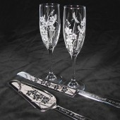 Orchid and Dragonfly wedding cake server, knife, and champagne glasses