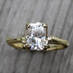 moissanite twig engagement ring with carved floral setting