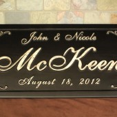 carved wooden established family name sign