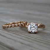 http://www.kristincoffin.com/products/forever-brilliant-moissanite-twig-engagement-diamond-seedling-band