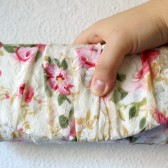 Floral gathered lace clutch