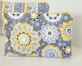 gray and yellow cosmetic bag