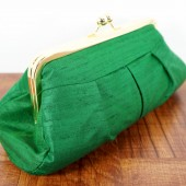 Green silk clutch with gold frame