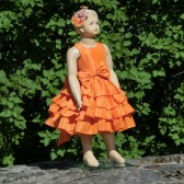 Orange ruffle flower girl dress