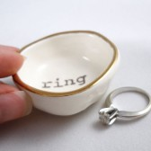 white earthenware wedding ring holder
