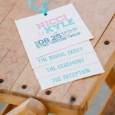 Tiered wedding programs in pink & tiffany blue