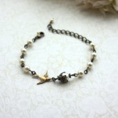 Swallow Bird, Ivory Swarovski Pearl, Antiqued Brass Bracelet.