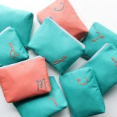 monogram Cosmetic Bag in Teal and Coral