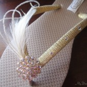 Gold Flip Flops. Sand color -Tan flip flops with golden ribbon & ivory feathers. CZ crystal button 18kg plated base - Arleny Collection