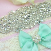 Emery Ivory Lace Rhinestone Garter With Mint Bow