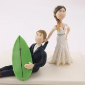 Bride dragging surfer groom