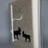 Wedding rustic old style photo album or scrapbook Two Black Moose shilluets and initials under the Birch tree