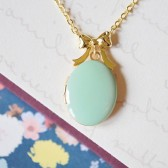 Mint Enamel Gold Locket Hanging from Gold Ribbon Charm