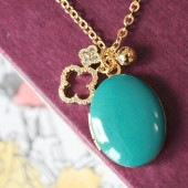 Enameled Gold Locket with Clover Leaf Charms