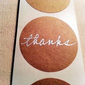 Hand Lettered Thanks Stickers in Silver on Kraft Brown Paper