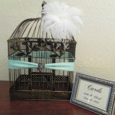 Birdcage Card Holder with white feathers and framed card sign