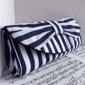 Wide nautical stripes bow clutch