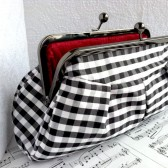 Gingham black and white silk clutch with red interior