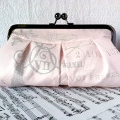 Blush pink clutch with French script
