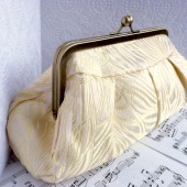 Cream and gold brocade silk clutch in frame