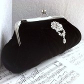 Black velvet clutch purse with brooch
