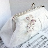 White cotton clutch with pink rhinestone brooch