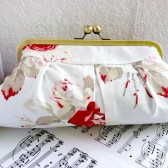 Ivory floral clutch with red roses