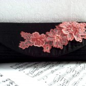 Black silk clutch with pink lace flower applique
