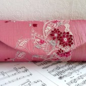 Pink silk clutch with floral lace overlay