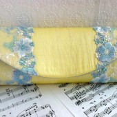 Yellow silk clutch with blue lace trim