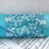 Turquoise blue silk clutch with lace