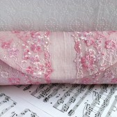 Pastel pink silk clutch with lace overlay