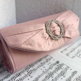 Blush pink bow clutch with rhinestone buckle
