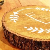 Personalized monogram sign on rustic tree slice