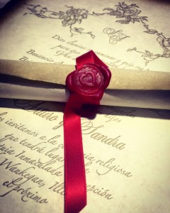 scroll wedding invitation with red wax seal