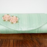Mint green pleated silk clutch