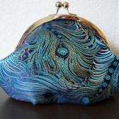 Blue peacock feather clutch wristlet