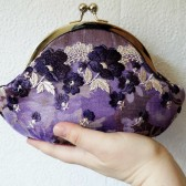 Purple wristlet clutch with lace
