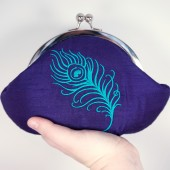 Purple clutch with turquoise peacock feather