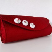 Red silk clutch with buttons
